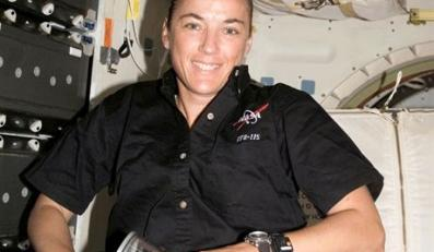 This unique photograph shows astronaut Heide Stefanyshyn-Piper activating growth of Salmonella bacteria for our spaceflight experiment on orbit during Space Shuttle Atlantis mission STS-115. This photograph illustrates the challenging and unique conditions during a spaceflight experiment that are rarely seen by most researchers. Image courtesy of National Aeronautics and Space Administration (NASA).fot. NASA